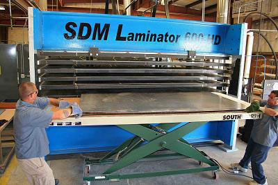 Image of the large 600 ton SDM Laminator panel press.